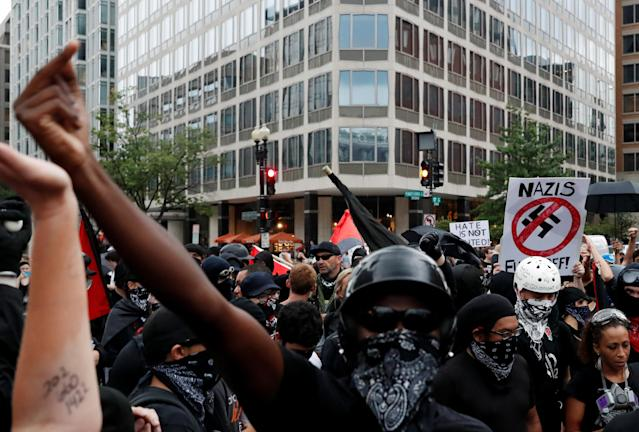 "<p>Antifascists, opponents of a white nationalist-led rally marking the one-year anniversary of the 2017 Charlottesville ""Unite the Right"" protests, gather in downtown Washington, U.S., August 12, 2018. (Photo: Leah Millis/Reuters) </p>"
