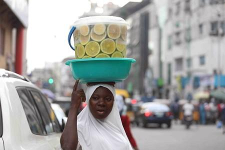 Woman hawks a local beverage along the central business area of Marina in Lagos