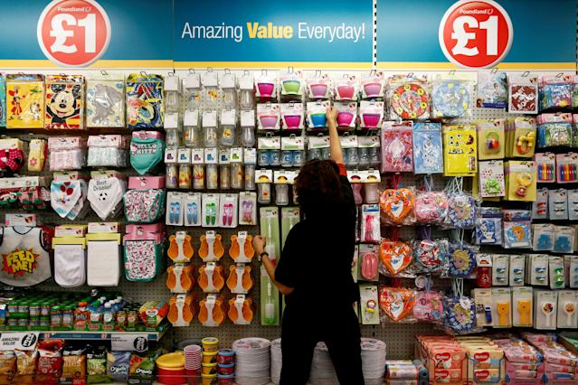 A Poundland employee checks products in a store in London. Photo: Stefan Wermuth/Reuters