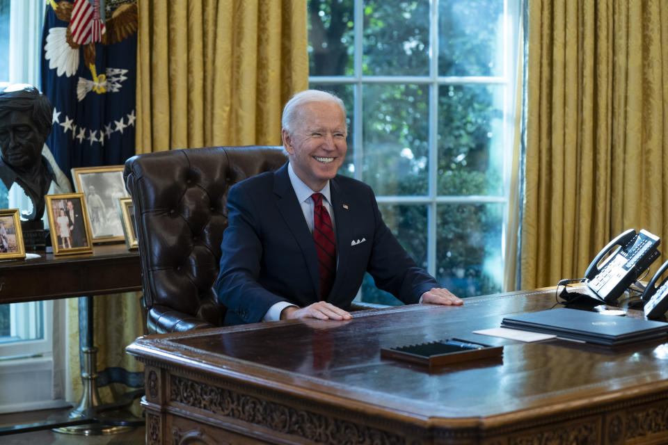 President Joe Biden smiles after signing a series of executive orders on health care, in the Oval Office of the White House, Thursday, Jan. 28, 2021, in Washington. (AP Photo/Evan Vucci)