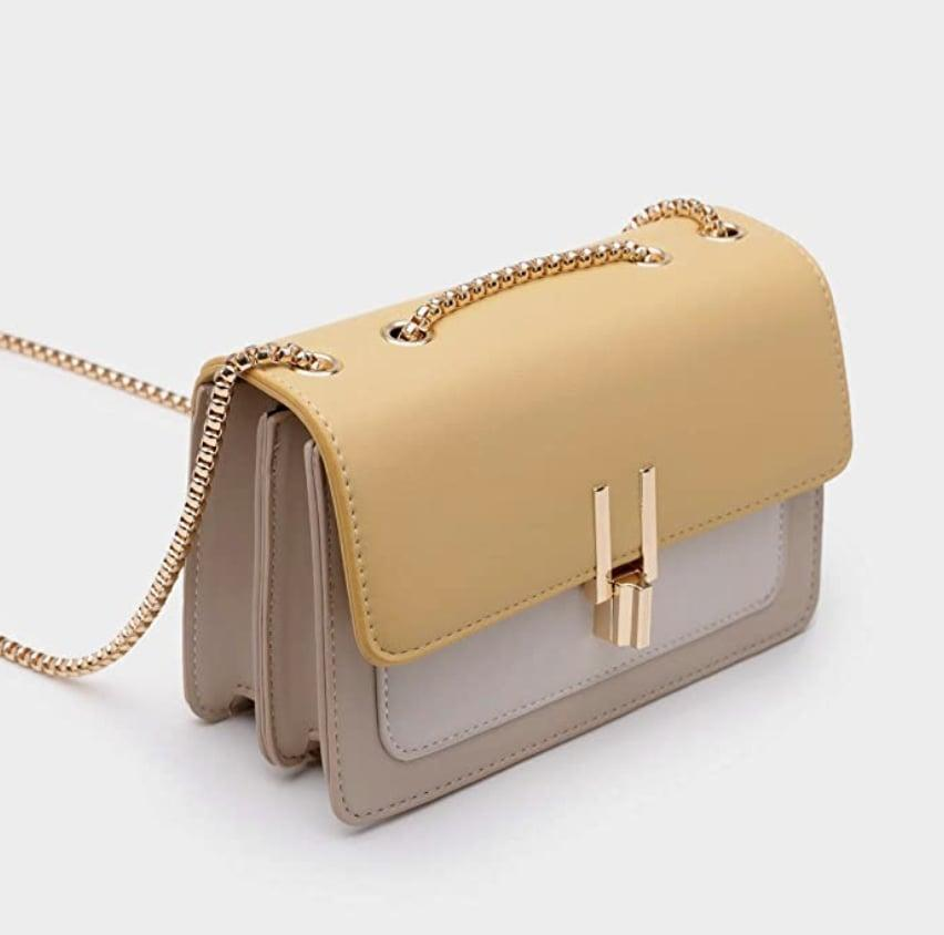 <p>Opt for a trendy and easy-to-style design like this <span>Top Band Color-Block Crossbody Bag</span> ($30, originally $40). The gold hardware adds a touch of glam, while the shape and size will keep all your belongings safe.</p>