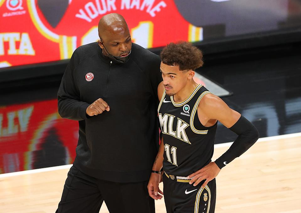 Nate McMillan has encouraged Trae Young to stay aggressive, but has helped him harness it to manage his game and lead the Hawks on this playoff run. (Kevin C. Cox/Getty Images)