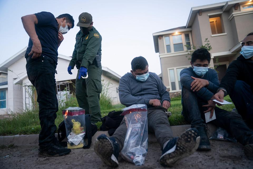 """Border Patrol agents detain more than a dozen people found hiding in a """"stash house,"""" a vacant, under-construction home in the town of Mission, Texas, near the U.S.-Mexican border July 13."""