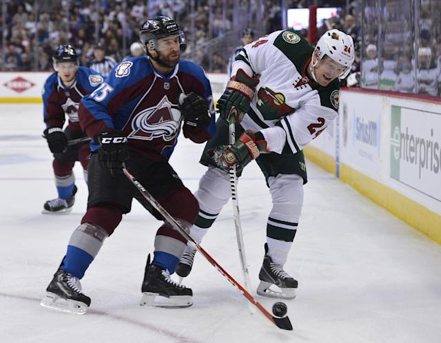 Colorado Avalanche center Maxime Talbot (25) and Minnesota Wild left wing Matt Cooke (24) skate in the first period of Game 2 of an NHL hockey first-round playoff series on Saturday, April 19, 2014, in Denver. (AP Photo/Jack Dempsey)