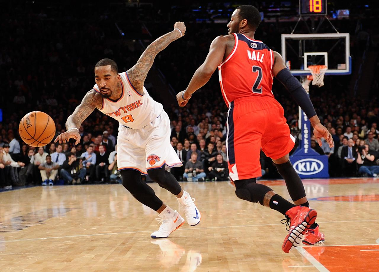NEW YORK, NY - DECEMBER 16: J.R. Smith #8 of the New York Knicks reaches for a loose ball against John Wall #2 of the Washington Wizards during the second half at Madison Square Garden on December 16, 2013 in New York City. NOTE TO USER: User expressly acknowledges and agrees that, by downloading and/or using this photograph, user is consenting to the terms and conditions of the Getty Images License Agreement. The Wizards defeat the Knicks 102-101. (Photo by Maddie Meyer/Getty Images)