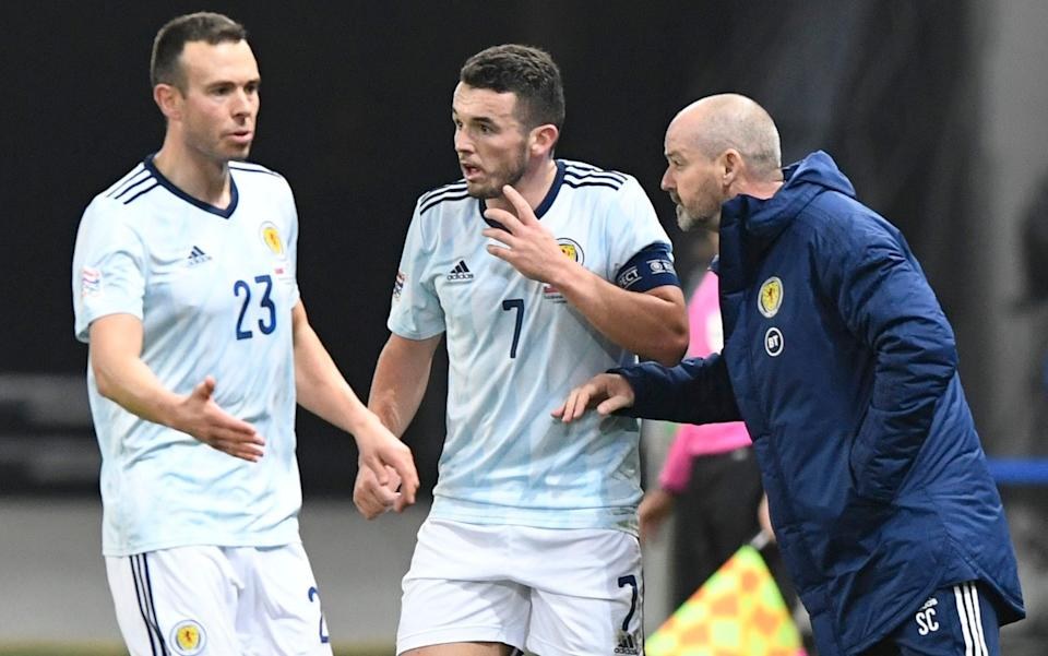 Scotland manager Steve Clarke gives instructions to John McGinn and Andrew Considine - REUTERS