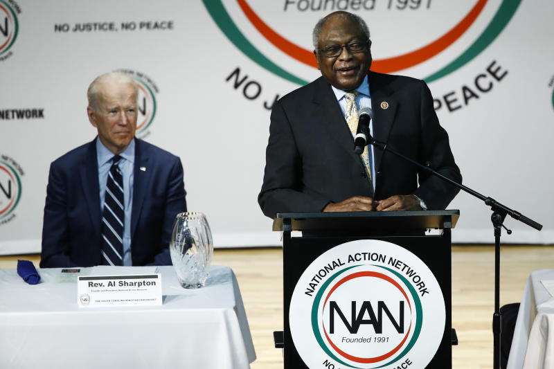 Democratic presidential candidate former Vice President Joe Biden, listens to Rep. James Clyburn, D-S.C., speak at the National Action Network South Carolina Ministers' Breakfast, Wednesday, Feb. 26, 2020, in North Charleston, S.C. (AP Photo/Matt Rourke)