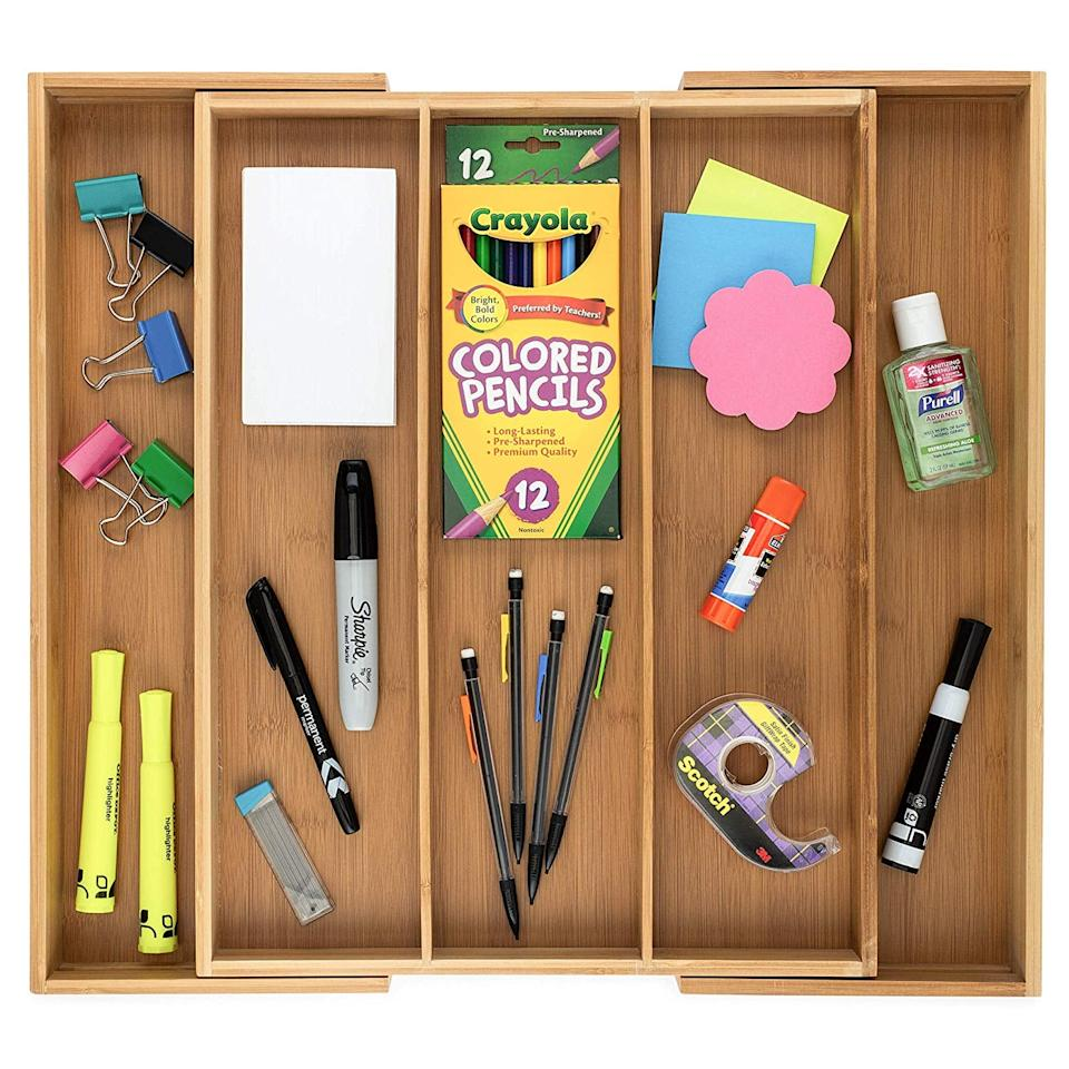 """<p>This <a href=""""https://www.popsugar.com/buy/Bamboo%20Expandable%20Drawer%20Organizer-471012?p_name=Bamboo%20Expandable%20Drawer%20Organizer&retailer=amazon.com&price=27&evar1=casa%3Aus&evar9=46407279&evar98=https%3A%2F%2Fwww.popsugar.com%2Fhome%2Fphoto-gallery%2F46407279%2Fimage%2F46407748%2FBamboo-Expandable-Drawer-Organizer&list1=shopping%2Corganizing%2Chome%20organization%2Chome%20shopping&prop13=mobile&pdata=1"""" rel=""""nofollow"""" data-shoppable-link=""""1"""" target=""""_blank"""" class=""""ga-track"""" data-ga-category=""""Related"""" data-ga-label=""""https://www.amazon.com/Expandable-Organizer-Bathroom-Adjustable-Compartments/dp/B07DNH9VWG/ref=sxbs_sxwds-stvp?keywords=multipurpose+organizer&amp;pd_rd_i=B07DNH9VWG&amp;pd_rd_r=6d795c04-af87-4449-9268-d61396a2ee82&amp;pd_rd_w=rqUpf&amp;pd_rd_wg=aOpj0&amp;pf_rd_p=a6d018ad-f20b-46c9-8920-433972c7d9b7&amp;pf_rd_r=5RK5G81DSK08R21T01JB&amp;qid=1563829658&amp;s=gateway"""" data-ga-action=""""In-Line Links"""">Bamboo Expandable Drawer Organizer</a> ($27) is great for that one drawer that's overflowing with everything or you can use it for your silverware.</p>"""