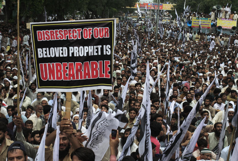 Thousands of supporters of a Pakistani religious group Jammat-Ud-Dawa Tehreek-e-Insaf or Movement for Justice take part in a demonstration in Lahore, Pakistan, Sunday, Sept. 16, 2012 as part of widespread anger across the Muslim world about a film ridiculing Islam's Prophet Muhammad. (AP Photo/K.M. Chaudary)