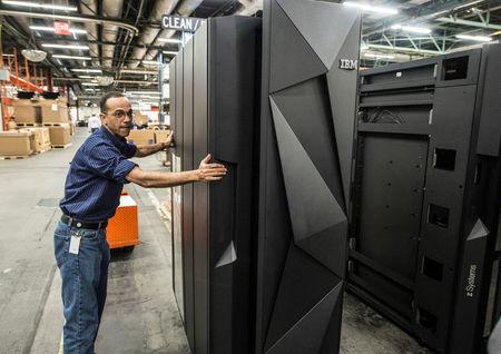 A worker guides the first shipment of an IBM System Z mainframe computer in Poughkeepsie