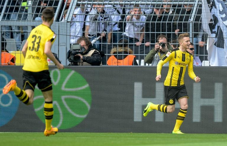 Dortmund's forward Marco Reus celebrates scoring during their match against Eintracht Frankfurt in Dortmund, western Germany, on April 15, 2017
