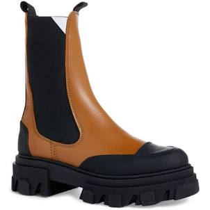 "<h2> Lug Chelsea Boot</h2><br><br>""If there is a must-have shoe of the season, it's the lug Chelsea boot. As the evolution from last fall's combat boot, this pull-on style is the perfect blend of fashion and function."" <br><br>Kate Bellman, Women's Fashion Managing Editor at Nordstrom <br><br><strong>Ganni</strong> Chelsea Boot, $, available at <a href=""https://go.skimresources.com/?id=30283X879131&url=https%3A%2F%2Fwww.nordstrom.com%2Fs%2Fganni-chelsea-boot-women%2F5743518%3Forigin%3Dcategory-personalizedsort%26breadcrumb%3DHome%252FWomen%252FShoes%252FBoots%26color%3Dtiger%2527s%2520eye"" rel=""nofollow noopener"" target=""_blank"" data-ylk=""slk:Nordstrom"" class=""link rapid-noclick-resp"">Nordstrom</a>"