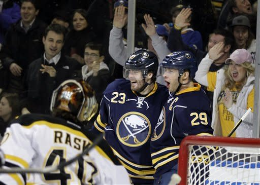Buffalo Sabres' Jason Pominville (29) celebrates his goal with Ville Leino (23), of Finland, on Boston Bruins' Tuukka Rask, of Finland, during the first period of an NHL hockey game in Buffalo, N.Y., Wednesday, Feb. 8, 2012. (AP Photo/David Duprey)