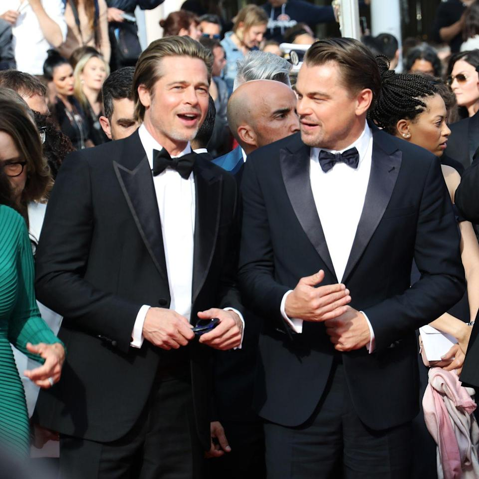 "<p>Pitt shares a laugh with <em>Once Upon a Time in Hollywood</em> costar Leonardo DiCaprio. The duo hit it off right away, in part because, Pitt revealed to <a href=""https://www.esquire.com/entertainment/movies/a27458589/once-upon-a-time-in-hollywood-leonardo-dicaprio-brad-pitt-quentin-tarantino-interview/"" rel=""nofollow noopener"" target=""_blank"" data-ylk=""slk:Esquire"" class=""link rapid-noclick-resp""><em>Esquire</em></a>, they both got their starts on <em>Growing Pains</em> (though they didn't cross paths on set).</p>"