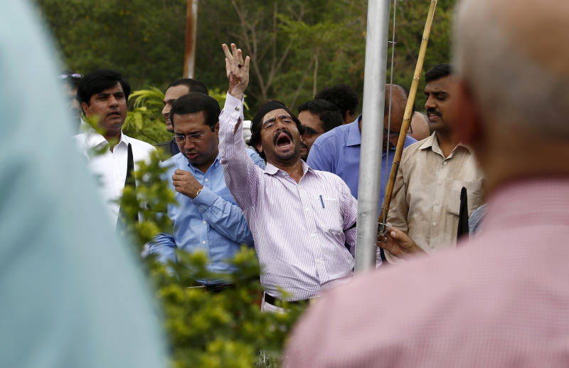 A journalist shouts slogans during a demonstration to denounce rampant censorship, in Islamabad, Pakistan, Tuesday, July 16, 2019. Pakistani journalists are holding nationwide protests to denounce rampant censorship by the country's powerful security services, massive layoffs due to budget cuts and months-long delays in payments of their wages. (AP Photo/Anjum Naveed)