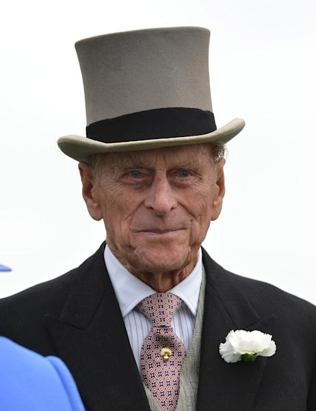 FILE - A Saturday June 2, 2012 file photo showing Britain's Prince Philip, viewing the horses from the parade ring before the Diamond Jubilee Coronation Cup race at Epsom Derby, Epsom, southern England, Saturday June 2, 2012 the first official day of the Queen's Diamond Jubilee celebrations. Buckingham Palace says Prince Philip, husband of Queen Elizabeth II, has been hospitalized with a bladder infection. The 90-year-old prince has been taking part in celebrations of the queenís Diamond Jubilee. (AP Photo/Ben Stansall, File, Pool)