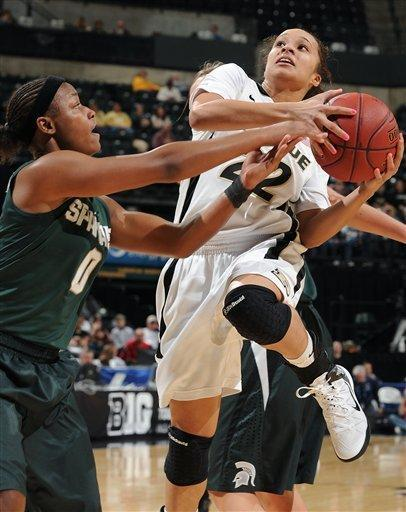 Purdue's KK Houser (22) is fouled by Michigan State's Kiana Johnson (0) during the first half of an NCAA college basketball game at the women's Big 10 tournament, Friday, March 2, 2012, in Indianapolis. (AP Photo/The Indianapolis Star, Matt Kryger) NO SALES
