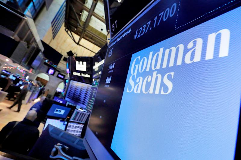 FILE - In this Dec. 13, 2016, file photo, the logo for Goldman Sachs appears above a trading post on the floor of the New York Stock Exchange. Goldman Sachs reports earnings Tuesday, July 17, 2018. (AP Photo/Richard Drew, File)