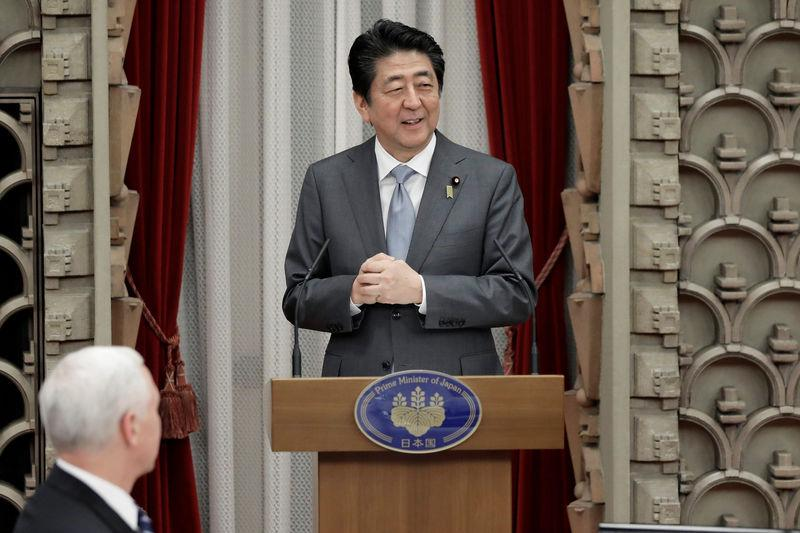 Japan's PM Abe delivers a speech while U.S. Vice President Pence listens during a banquet hosted by Abe at the prime minister's official residence in Tokyo