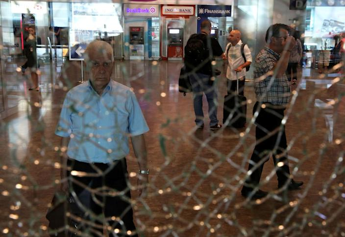 <p>A man looks at a broken glass at Istanbul Ataturk airport, Turkey, following yesterday's blast June 29, 2016. (REUTERS/Goran Tomasevic) </p>