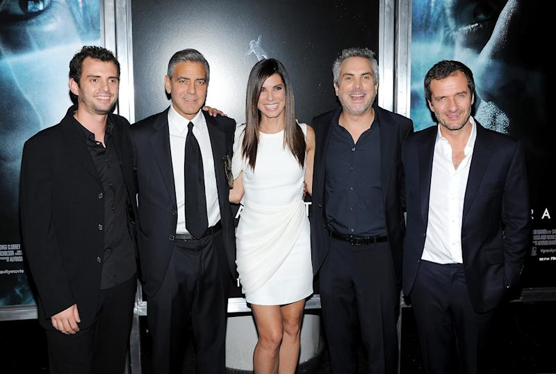 "FILE - In this Oct. 1, 2013 file photo, from left, screenwriter Jonas Cuaron, actor George Clooney, actress Sandra Bullock, director Alfonso Cuaron and producer David Heyman pose together at the premiere of ""Gravity"" at the AMC Lincoln Square Theaters, in New York. Author Tess Gerritsen is suing the studio behind the hit film ""Gravity"" claiming it is based on one of her novels. Gerritsen's lawsuit filed Tuesday, April 29, 2014, against Warner Bros. Entertainment Inc. seeks more than $10 million from the studio behind the Oscar-winning film, which starred Sandra Bullock. (Photo by Evan Agostini/Invision/AP, file)"