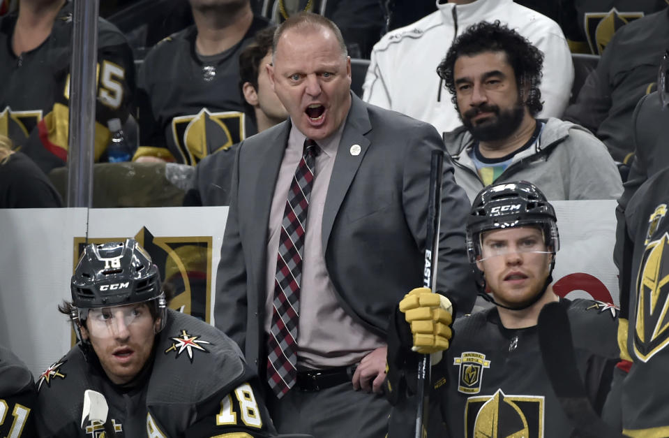 """FILE - Then-Vegas Golden Knights head coach Gerard Gallant calls out from the bench during the third period of an NHL hockey game against the Chicago Blackhawks in Las Vegas, in this Tuesday, Feb. 13, 2018, file photo. Gallant takes on a new challenge as coach of the New York Rangers, looking to """"take a big step"""" with a young team that ownership and management thinks should be a contender. It's very different than his previous stints with expansion Vegas and Florida. (AP Photo/David Becker, File)"""