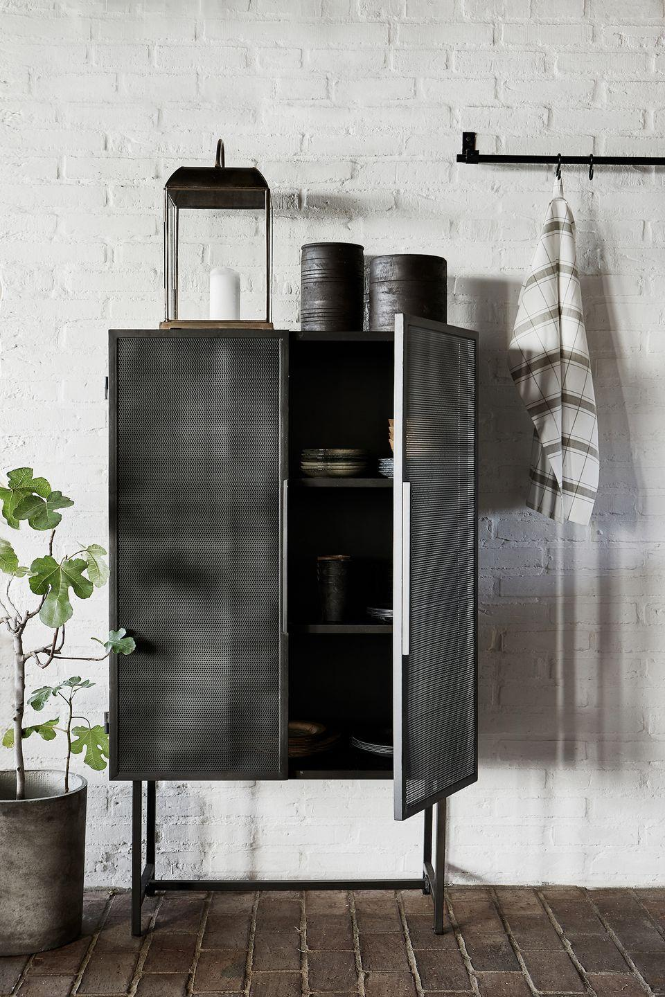 """<p>Often it's the layout of a kitchen that needs an overhaul. If your cupboards are full to the brim and utensils are never to hand, a freestanding piece such as a <a href=""""https://www.housebeautiful.com/uk/decorate/kitchen/g27318935/kitchen-larder-ideas/"""" rel=""""nofollow noopener"""" target=""""_blank"""" data-ylk=""""slk:larder cupboard"""" class=""""link rapid-noclick-resp"""">larder cupboard</a> could free up space elsewhere, meaning you can finally fit the mugs next to the kettle!</p><p>Pictured: Collect cabinet by House Doctor, <a href=""""https://www.nunido.co.uk/"""" rel=""""nofollow noopener"""" target=""""_blank"""" data-ylk=""""slk:Nunido"""" class=""""link rapid-noclick-resp"""">Nunido</a></p>"""