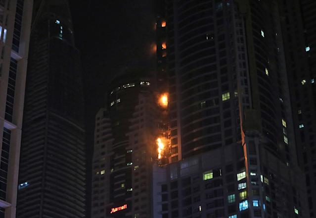 <p>Smoke and fire rise from a high rise building at Marina district in Dubai, U.A.E., Friday, Aug. 4, 2017. (Photo: Kamran Jebreili/AP) </p>