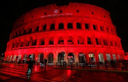 The Colosseum is lit up in red to draw attention to the persecution of Christians around the world in Rome, Italy, February 24, 2018. REUTERS/Remo Casilli