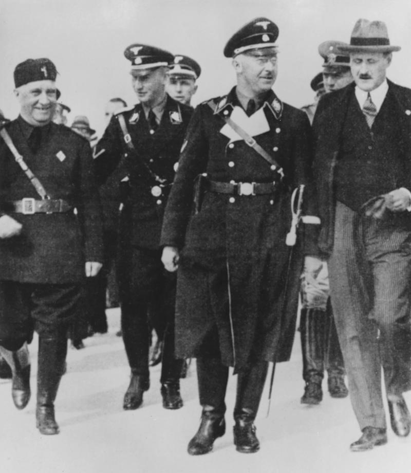Henrich Himmler visiting Rome with Reinhard Heydrich on his right and the ambassador Ulrich von Hassell on his left, October 1936 (Photo: DEA PICTURE LIBRARY via Getty Images)