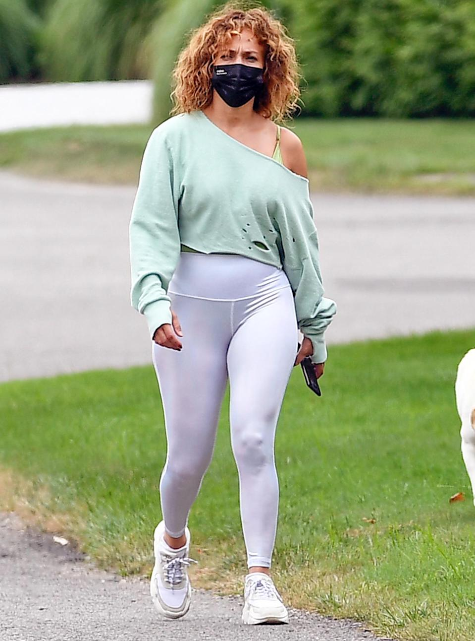 <p>Jennifer Lopez goes for a walk in Water Mill, New York, on Wednesday wearing a green sweater and white tights.</p>