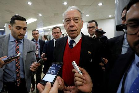 FILE PHOTO - Sen. Chuck Grassley speaks with reporters ahead of votes on Capitol Hill in Washington, U.S., December 6, 2017. REUTERS/Aaron P. Bernstein