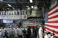 US Vice President Kamala Harris speaks to troops as she visits the USS Tulsa in Singapore