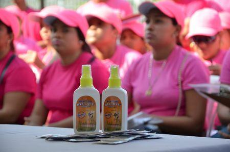 Mosquito repellent and condoms are seen in front of health workers during a campaign to fight the spread of Zika virus in Soledad municipality near Barranquilla, Colombia, in this February 1, 2016 handout photo supplied by the Soledad Municipality. REUTERS/Aleydis Coll/Soledad Municipality/Handout via Reuters