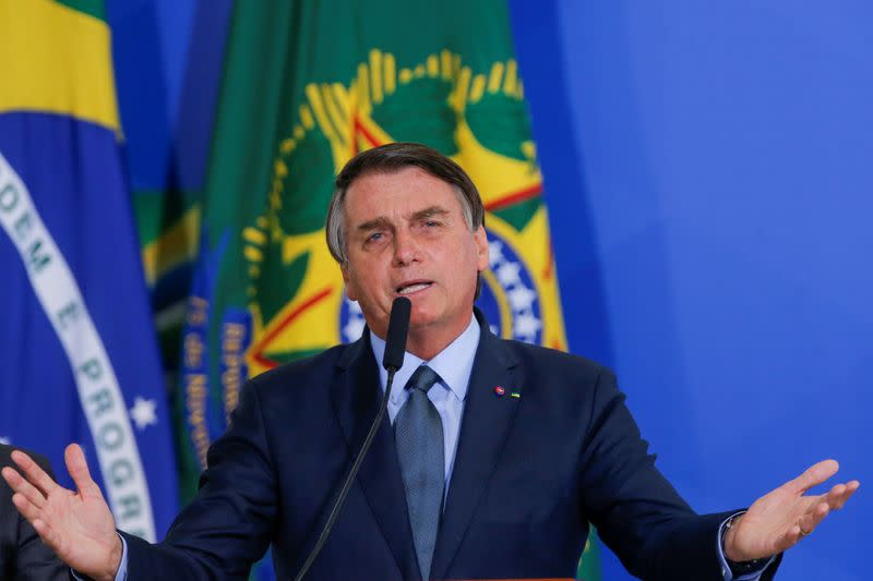 FILE PHOTO: Brazil's President Jair Bolsonaro speaks during an inauguration ceremony of the new Health Minister