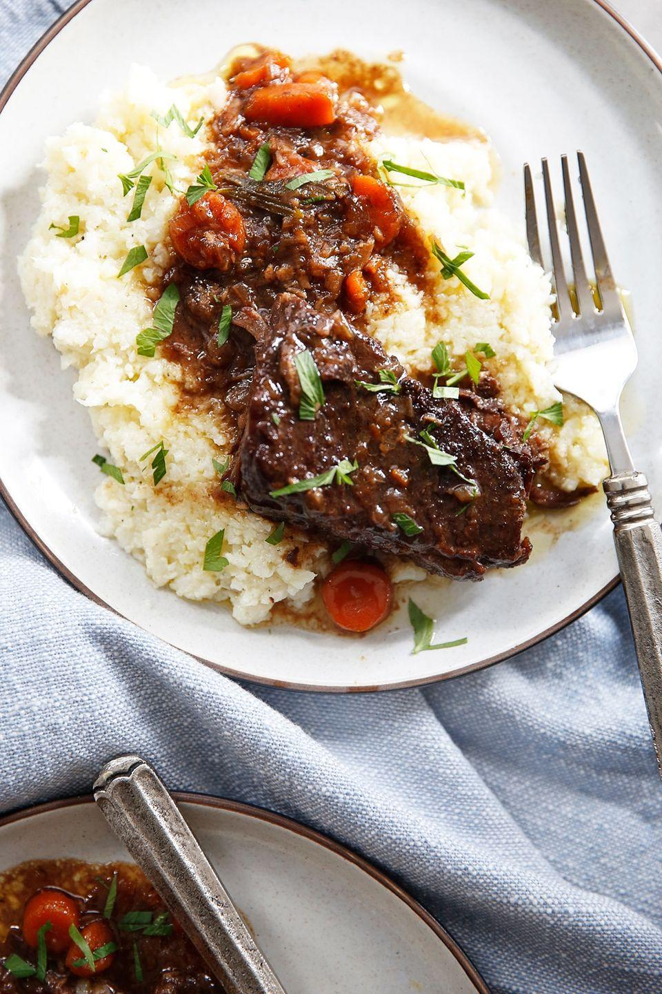 """<p>These beef short ribs by<a href=""""https://lexiscleankitchen.com/instant-pot-beef-short-ribs/"""" rel=""""nofollow noopener"""" target=""""_blank"""" data-ylk=""""slk:Lexi's Clean Kitchen"""" class=""""link rapid-noclick-resp""""> Lexi's Clean Kitchen</a> swap mashed potatoes for cauliflower mash to make it lower in carbs and higher in fiber to promote weight loss. Short ribs offer a nice amount of protein to keep you full and the grass-fed butter or olive oil provide good-for-you fats. A tip? Boneless beef will decrease the cooking time.</p>"""