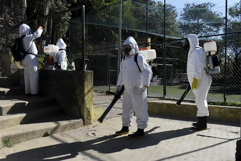 RIO DE JANEIRO, BRAZIL - JULY 25: Sanitary staff disinfect around against the novel coronavirus (COVID-19) pandemic in the Santa Marta Favela, south of the city, Rio de Janeiro, Brazil on July 25, 2020. Brazil has 85,562 thousand confirmed deaths from coronavirus until 1 pm on Saturday. (Photo by Fabio Teixeira/Anadolu Agency via Getty Images)