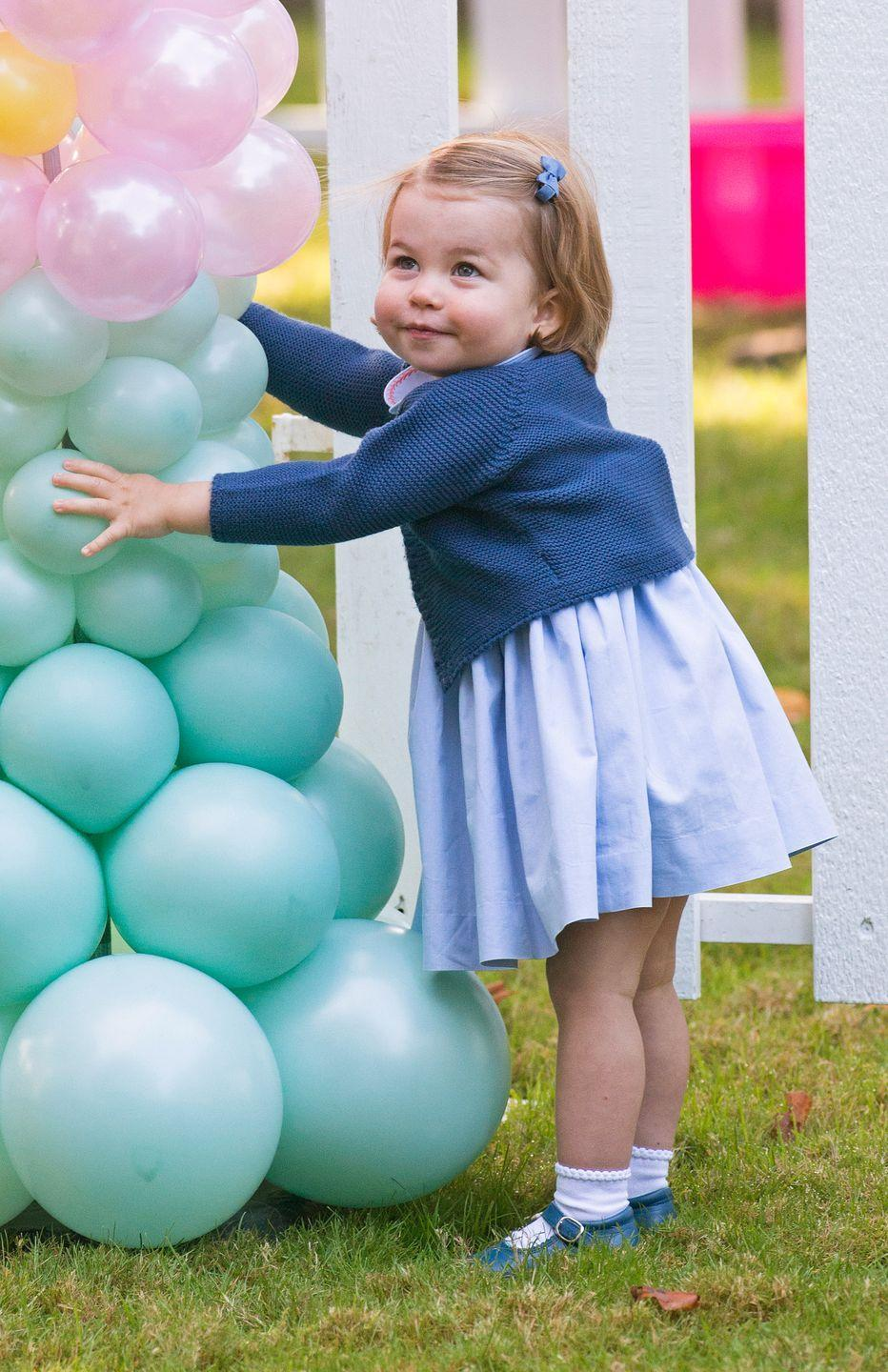 <p>Charlotte is overjoyed at the sight of balloons during an official tour of Canada with her parents and big brother in September 2016. </p>