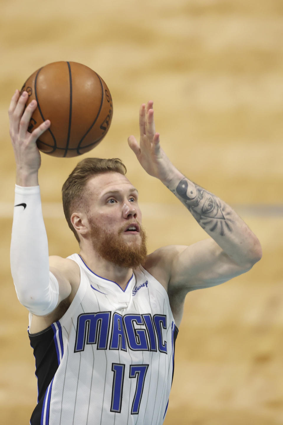 Orlando Magic forward Ignas Brazdeikis shoots against the Charlotte Hornets during the second half of an NBA basketball game in Charlotte, N.C., Friday, May 7, 2021. (AP Photo/Nell Redmond)