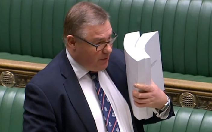 Mark Francois holds up his copy of the trade agreement in the House of Commons - Getty Images