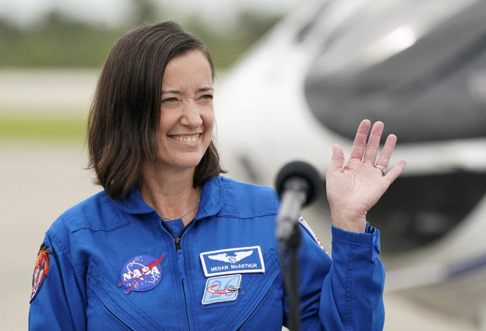 SpaceX Crew 2 member, NASA astronaut Megan McArthur waves as she arrives at the Kennedy Space Center in Cape Canaveral, Fla., Friday, April 16, 2021. The launch to the International Space Station is targeted for April 22. (AP Photo/John Raoux)