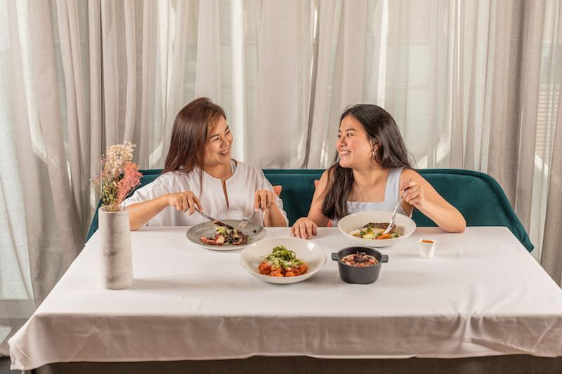 Picture of mother and daughter enjoying a meal