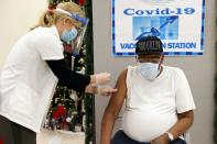 FILE PHOTO: George Valley, a patient at Crown Heights Center for Nursing and Rehabilitation, receives the Pfizer-BioNTech COVID-19 vaccine from Walgreens Pharmacist Annette Marshall in Brooklyn