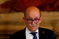 FILE PHOTO: Portugal's Foreign Minister Augusto Santos Silva meets with his French counterpart Jean-Yves Le Drian in Lisbon