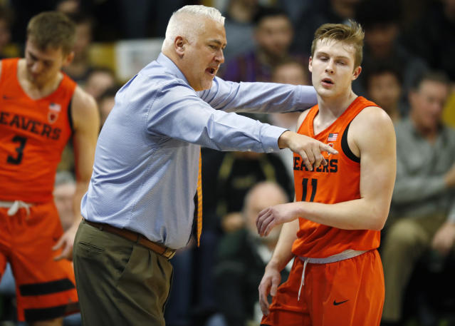 Oregon State head coach Wayne Tinkle, left, directs guard Zach Reichle as he returns to the bench in the first half of an NCAA college basketball game against Colorado, Thursday, Jan. 31, 2019, in Boulder, Colo. (AP Photo/David Zalubowski)