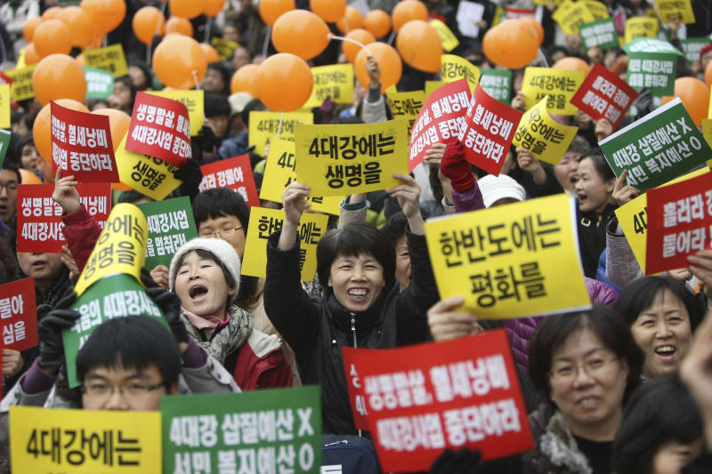 Anti-government supporters shout slogans and hold banners during a rally against the governments policies and financial plans, Sunday, Dec. 5, 2010 in Seoul , South Korea. South Korea's top trade official Kim Jong-hoon on Sunday defended a hard-fought compromise with the United States on a stalled free trade agreement by rejecting accusations that his government gave up too much to seal the deal. (AP Photo/Wally Santana)
