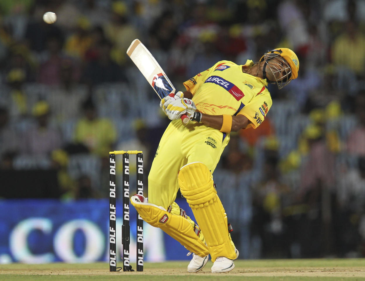Chennai Super Kings batsman Subramaniam Badrinath avoids a bouncer from Pune Warriors bowler Ashish Nehra during the IPL Twenty20 cricket match between Chennai Super Kings and Pune Warriors at The M.A. Chidambaram Stadium in Chennai on April 19, 2012.