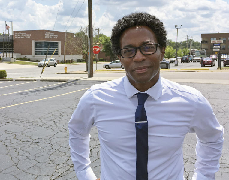 FILE - In this Aug. 8, 2018 photo, Wesley Bell stands outside the Ferguson, Mo., police headquarters a day after he defeated longtime St. Louis County prosecutor Bob McCulloch in the Democratic primary. Bell's 57 percent to 43 percent victory over McCulloch, a white prosecutor first elected in 1990, is the latest win for the Black Lives Matter movement, which has increasingly shifted from protest to local politics in recent years. Voters concerned with the killing of unarmed black people by police have made their voices heard from Ferguson to Cleveland to Chicago. (AP Photo/Jim Salter, File)