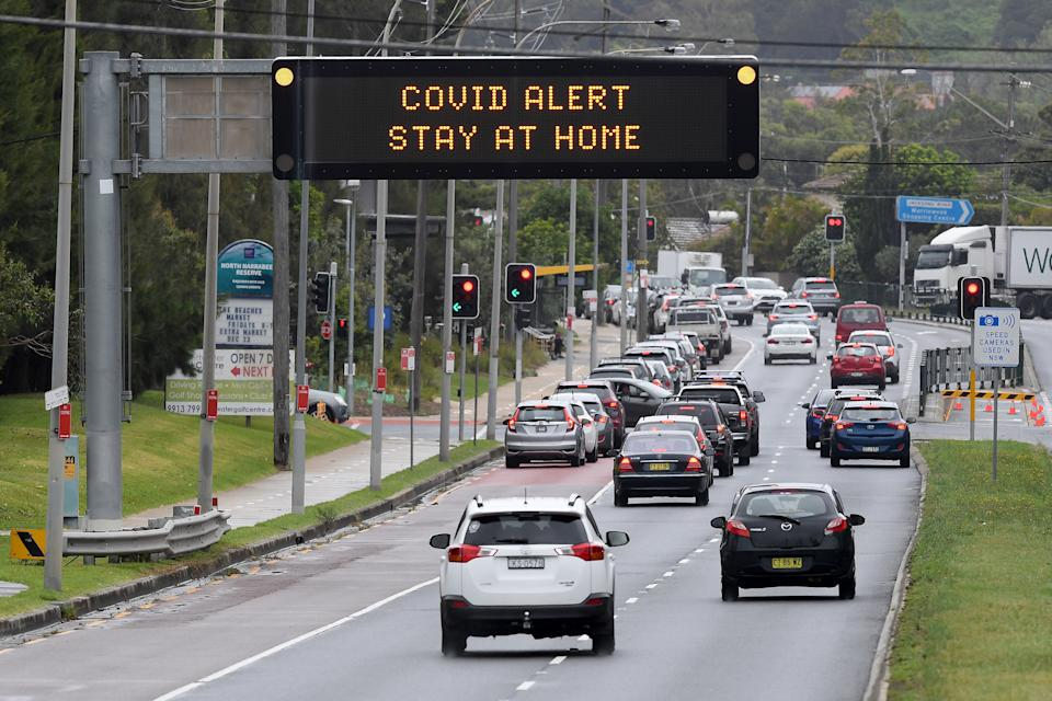 Cars are seen queuing for a drive-thru COVID-19 testing clinic on Pittwater road at Warriewood on the Northern Beaches, amid a new Covid cluster