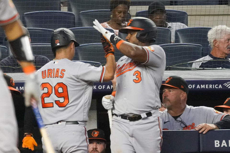 Baltimore Orioles' Ramon Urias (29) celebrates with Maikel Franco (3) after hitting a solo home run in the fourth inning of a baseball game against the New York Yankees, Monday, Aug. 2, 2021, in New York. (AP Photo/Mary Altaffer)
